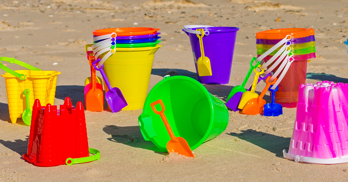 Assorted colorful sand pails and buckets