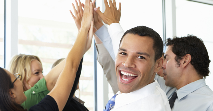 coworkers high-fiving at work