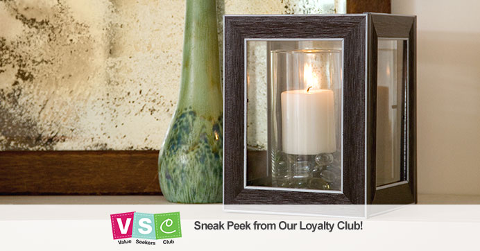 DIY Lantern made with frames and a candleholder