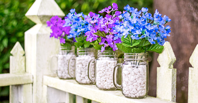Pint Jar Mugs filled with stones and faux flowers