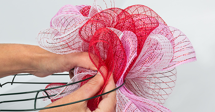 Push Deco Mesh Through Heart Wreath Form