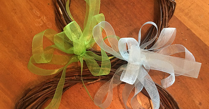 add ribbon bows to the wreath