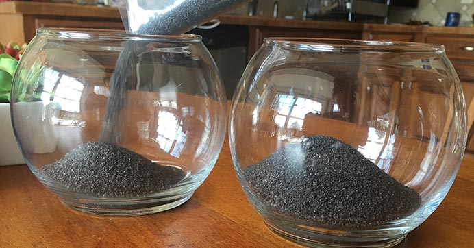 Pour sand into the glass bowls