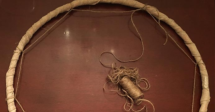 Wrap twine around the hoop