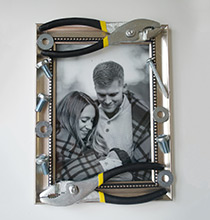 Looking for a thoughtful and unique craft to make Dad for Father's Day? Create this DIY picture frame for your hardworking loved one. Decorate a picture frame with a variety of tools and hardware, all available at Dollar Tree. Insert a photo of a special memory you share together. Pair this frame with more handy tools or a gift card he can use for his next project. Shop at Dollar Tree – Here's What You'll Need: Tools/Hardware Picture Frame Photograph Hot Glue Gun (Not Available at Dollar Tree) Hot Glue Sticks Easy Step-by-Step Directions: Arrange and apply your tools and hardware directly to your photo frame using hot glue. Allow the tools to dry flat for two minutes before moving the frame. Insert your special photograph. Gift this special frame to your Dad for Father's Day! Fun Tip: This gift idea is so affordable, you can create many versions for all the new parents, friends, grandfathers, and siblings in your life! Looking for additional gifts to give this Father's Day? Check out these 4 easy DIY gifts kids can make for Father's Day!